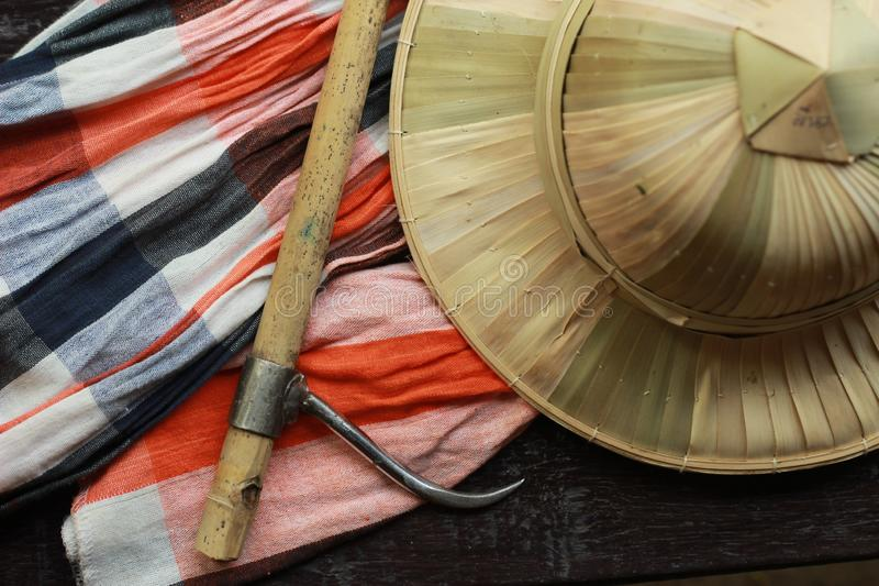 flat lay details showing the tools and colorful clothing and bamboo woven hat of a traditional Northern Thailand Thai Elephant royalty free stock images