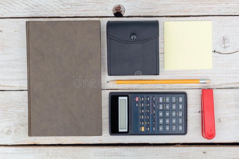 Flat lay: diary and calculator stock image