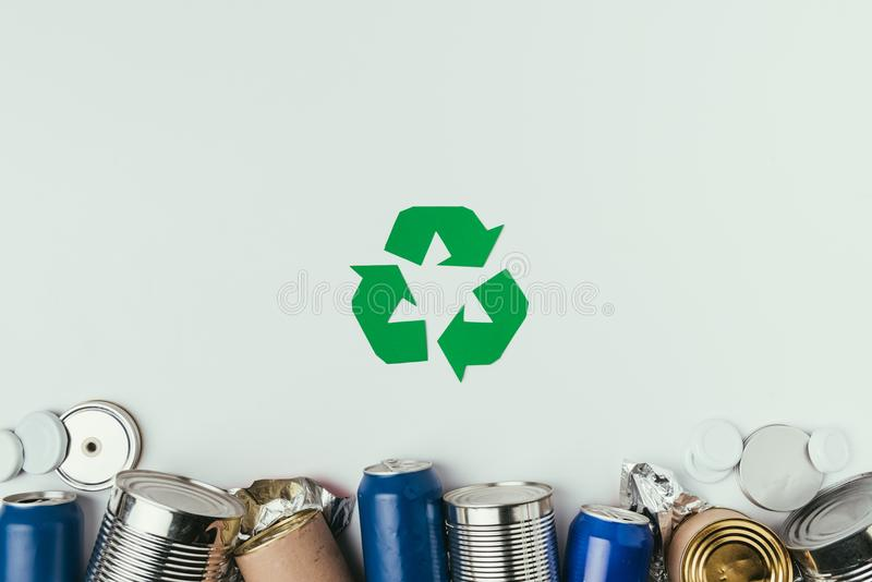 Flat lay with different cans and recycle sign. Isolated on grey stock image