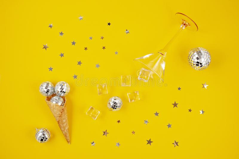 Flat lay with disco balls in the cone, ice cubes, cocktail glass stock photos