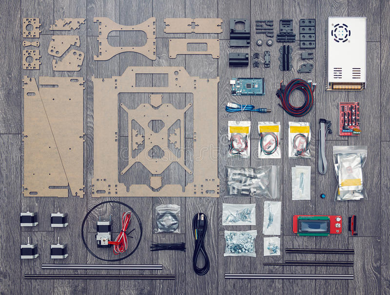 Flat lay of electronic and mechanical parts and components of DI. Y 3d printer on wooden surface royalty free stock photo
