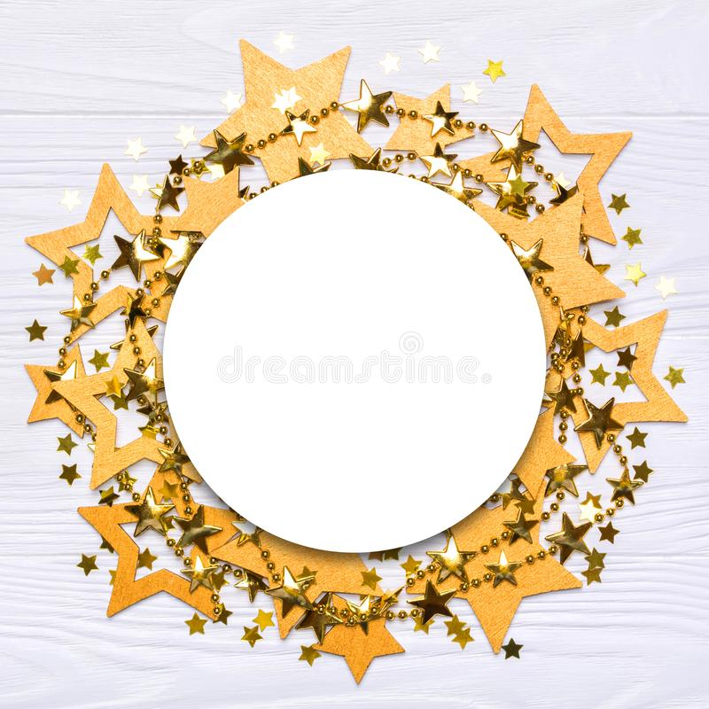Flat lay empty round frame of big and small stars of confetti stock photos