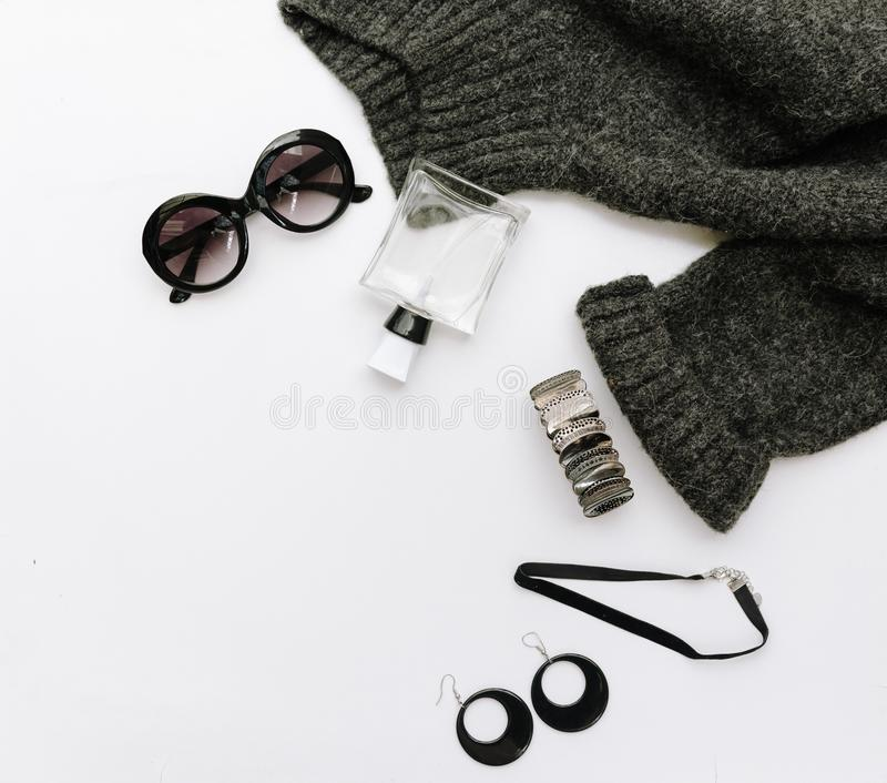 Flat lay fashion composition with warm sweater, sunglasses and watches royalty free stock photos