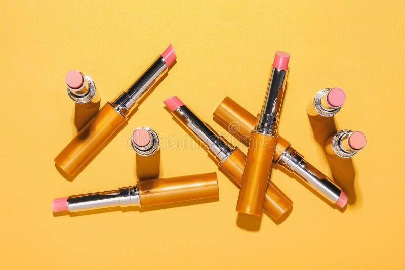 Flat lay fashion with lipsticks, Essential beauty item. Flat lay fashion with golden lipsticks, Essential beauty item royalty free stock images