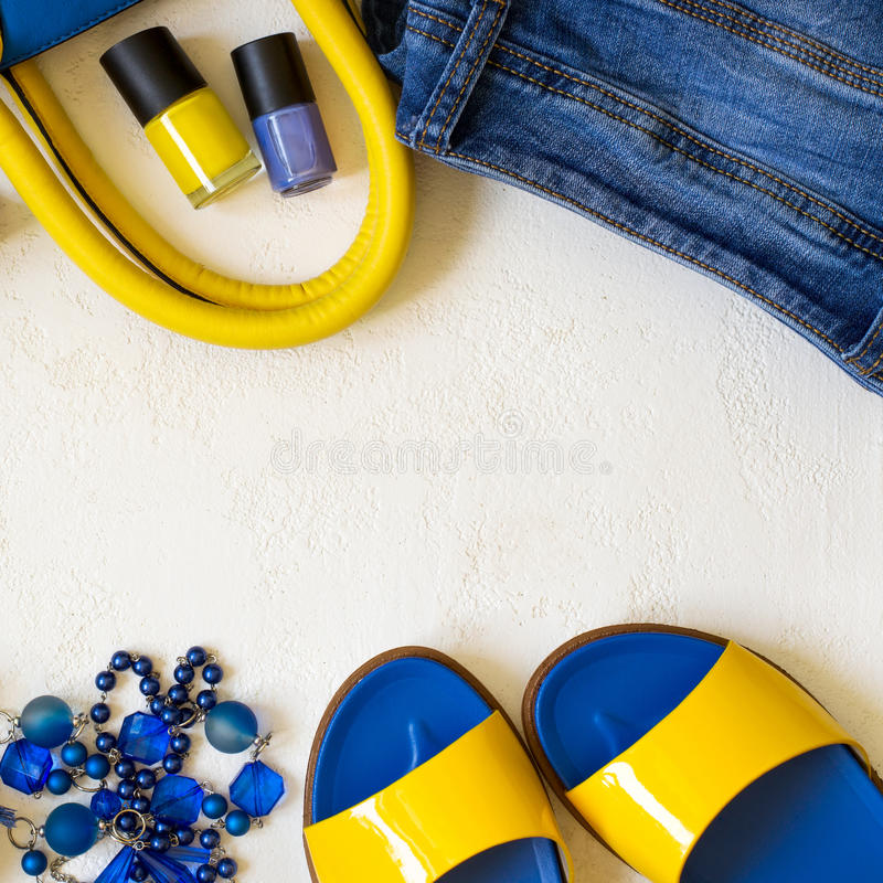 Flat lay Female clothing and accessories in bright yellow blue s stock image