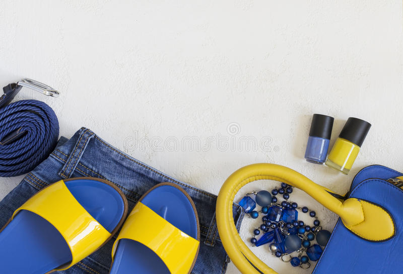 Flat lay Female clothing and accessories in bright yellow blue s royalty free stock image