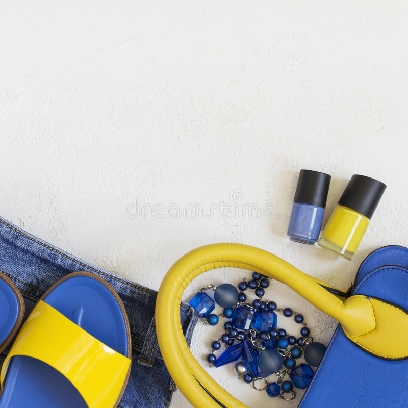 Flat lay Female clothing and accessories in bright yellow blue s royalty free stock photos