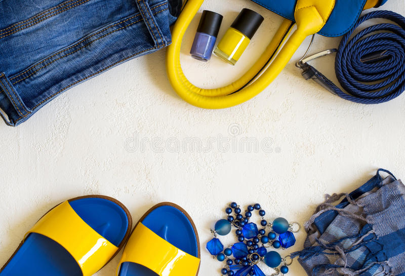 Flat lay Female clothing and accessories in bright yellow blue s stock photo