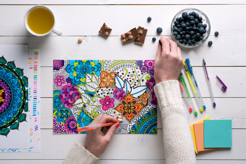 Flat lay, female coloring adult coloring book stock photo