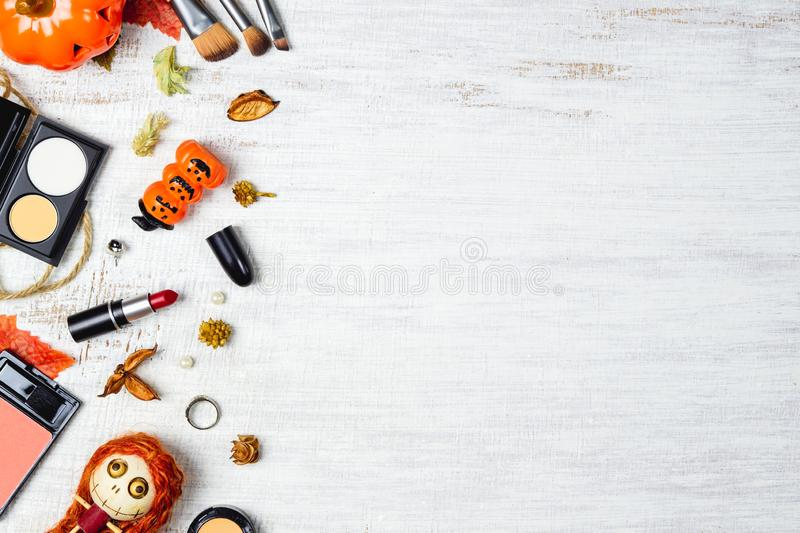 Flat lay Female cosmetics in Autumn and Halloween festival background concept. Top view with copy space for your text. Above, abstract, accessories royalty free stock photo