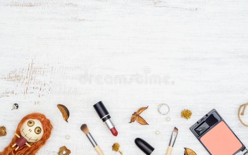 Flat lay Female cosmetics in Autumn and Halloween festival background concept. Top view with copy space for your text royalty free stock photos