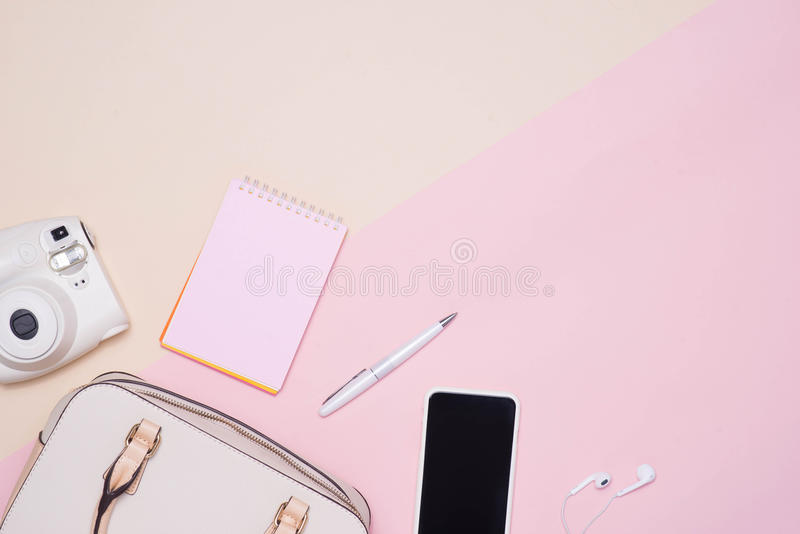 Flat lay of female fashion accessories and white handbag on past royalty free stock photos