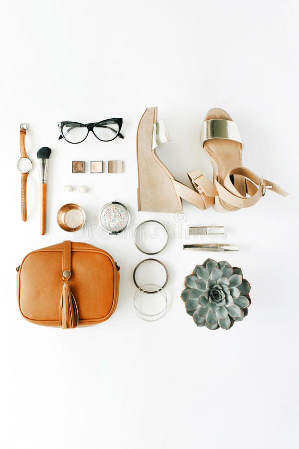 Flat lay feminine accessories collage with purse, watch, glasses, bracelet, lipstick, sandals, mascara, brushes stock photos
