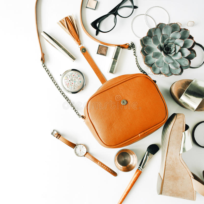 Flat lay feminine accessories collage with purse, watch, glasses, bracelet, lipstick, sandals, mascara, brushes royalty free stock photos