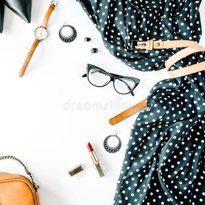 Flat lay feminine clothes and accessories collage with black dress, glasses, high heel shoes, purse, watch, mascara, lipstick, ear stock image