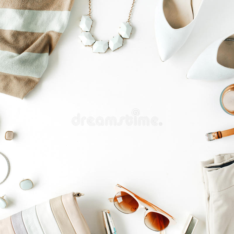 flat lay feminine clothes and accessories collage with cardigan, trousers, sunglasses, watch, bracelet, lipstick, mint high heel stock images