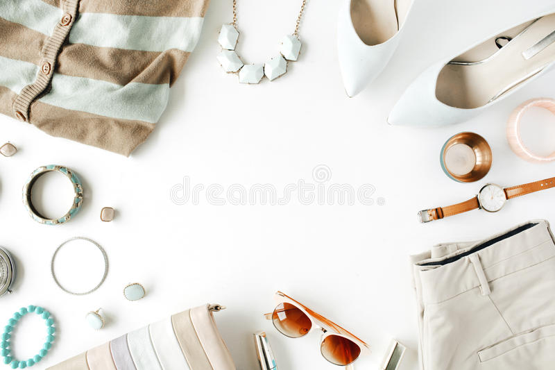 Flat lay feminine clothes and accessories collage with cardigan, trousers, sunglasses, watch, bracelet, lipstick, mint high heel. Shoes, earrings and purse on royalty free stock photos