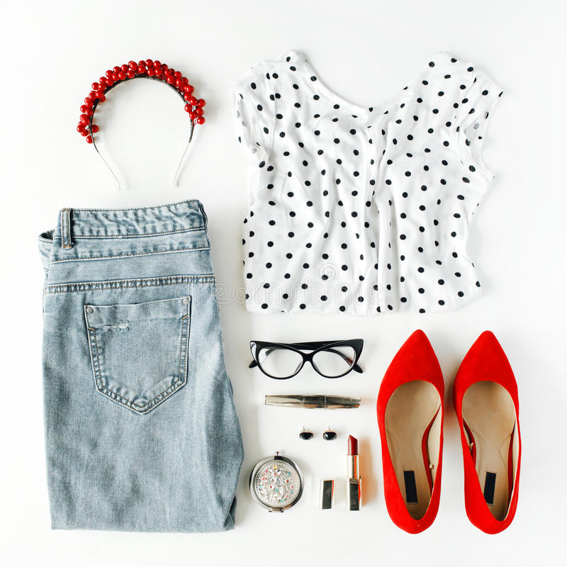 Flat lay feminine clothes and accessories collage with shirt, jeans, glasses, mascara, lipstick, red high heel shoes, earrings and stock photography