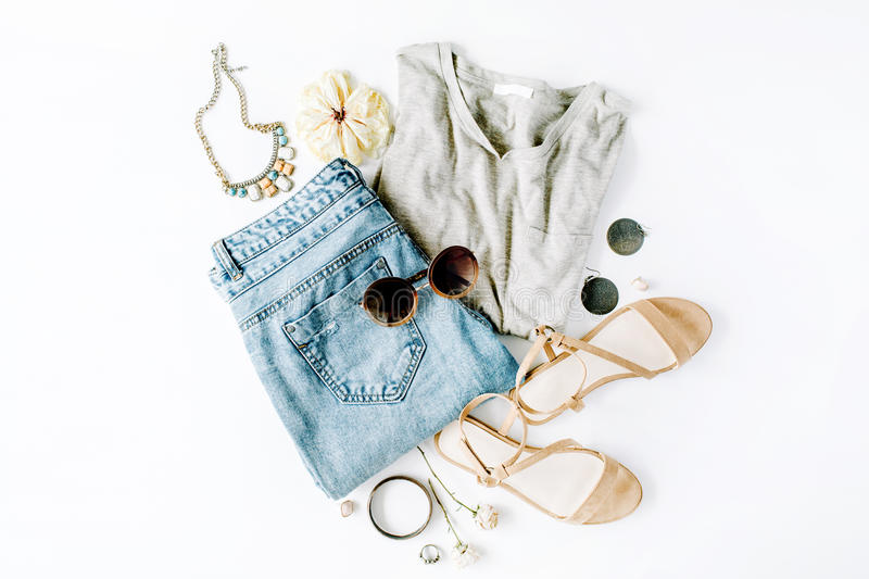 Flat lay feminine clothes and accessories collage with shirt, jeans shorts, sunglasses, bracelet, sandals, earrings stock images