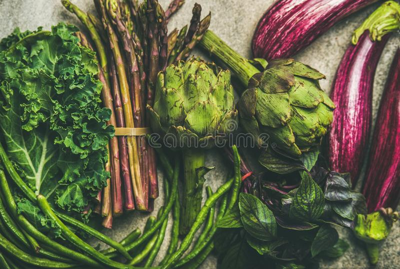 Flat-lay of fresh green and purple vegetables, clean eating stock photos