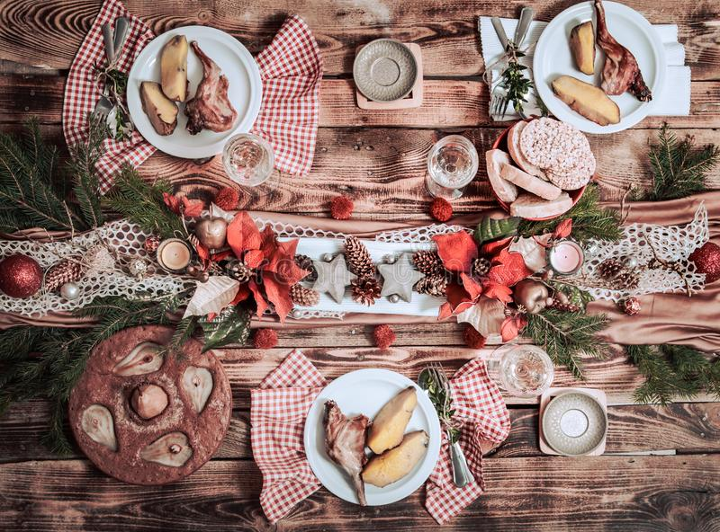 Flat-lay of friends hands eating and drinking together. Top view of people having party, gathering, celebrating together at wooden royalty free stock images