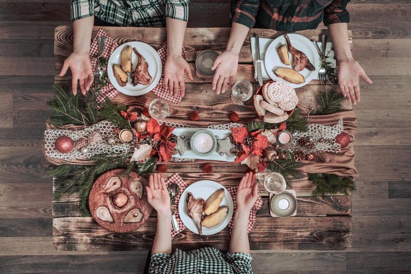 Flat-lay of friends hands eating and drinking together. Top view of people having party, gathering, celebrating together at wooden royalty free stock photos