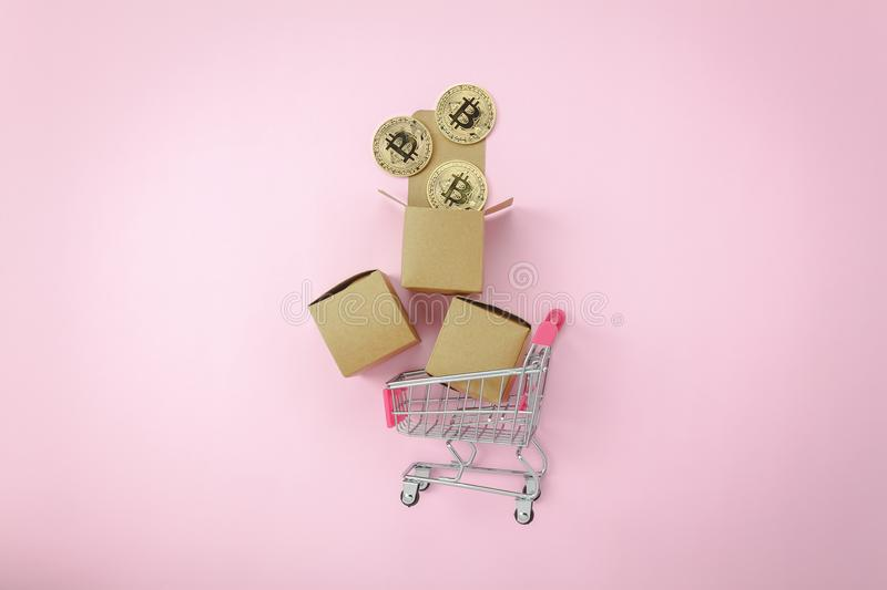 Flat lay graph growth up with coin money & shopping cart or trolley on modern pink paper. Table top view aerial image of business finance background.Flat lay royalty free stock photos