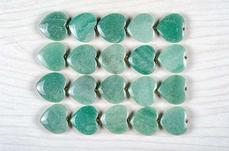 Flat lay green aventurine hearts royalty free stock photo