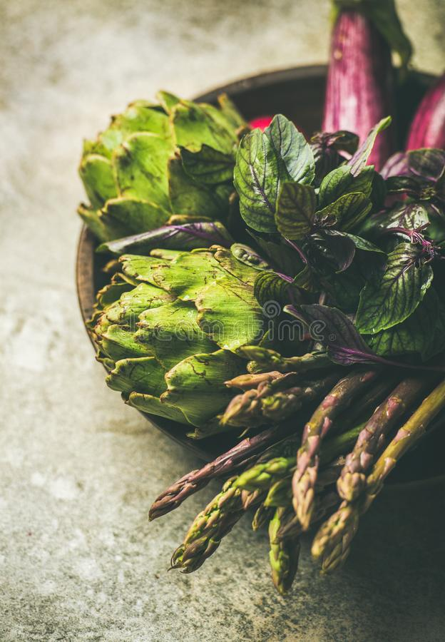 Flat-lay of green and purple vegetables on plate, selective focus stock photography