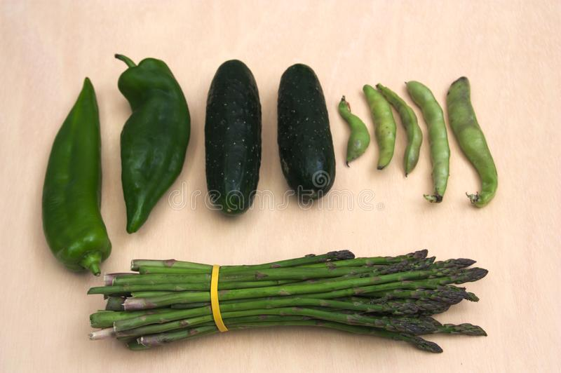 A flat lay of green vegetables stock images