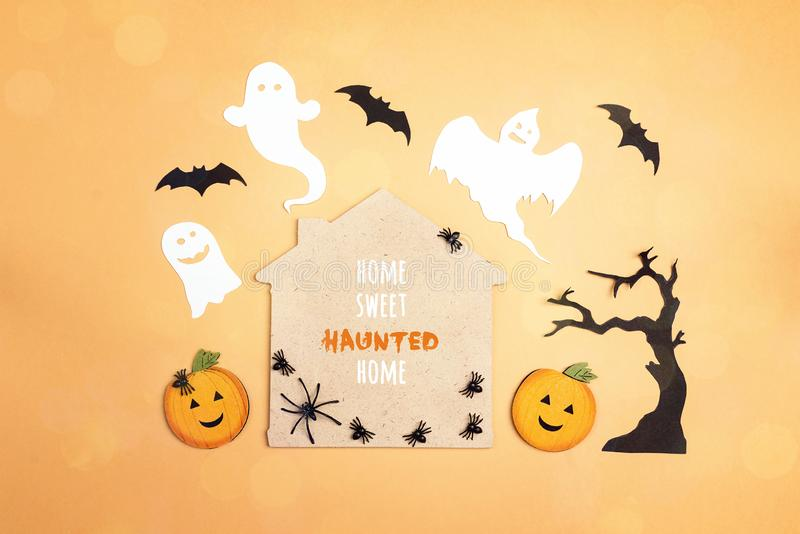 Flat lay Halloween background with cartoon house, spiders,pumpkins and ghosts. Home sweet haunted home royalty free stock photo