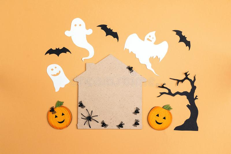 Flat lay Halloween background with cartoon house, spiders,pumpkins and ghosts. Copy space for text royalty free stock images
