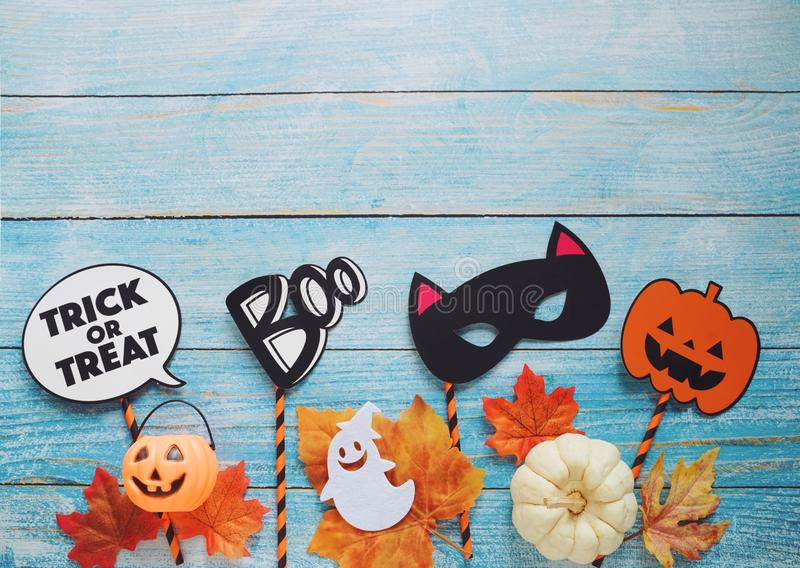 Flat lay of halloween prop for photo booth and party on blue wooden background with copy space royalty free stock photography