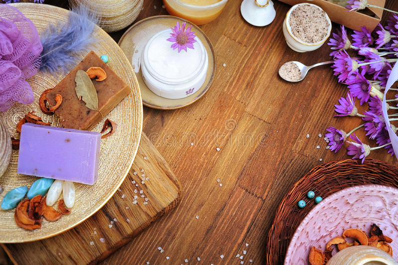 Flat lay handmade organic cosmetics: cream, artisan soap, bath salt stock images