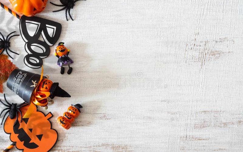 Flat lay Happy Halloween festival background concept. Mix varietyof accessory decoration objects on the grunge rustic white wood. Top view with copy space royalty free stock photos