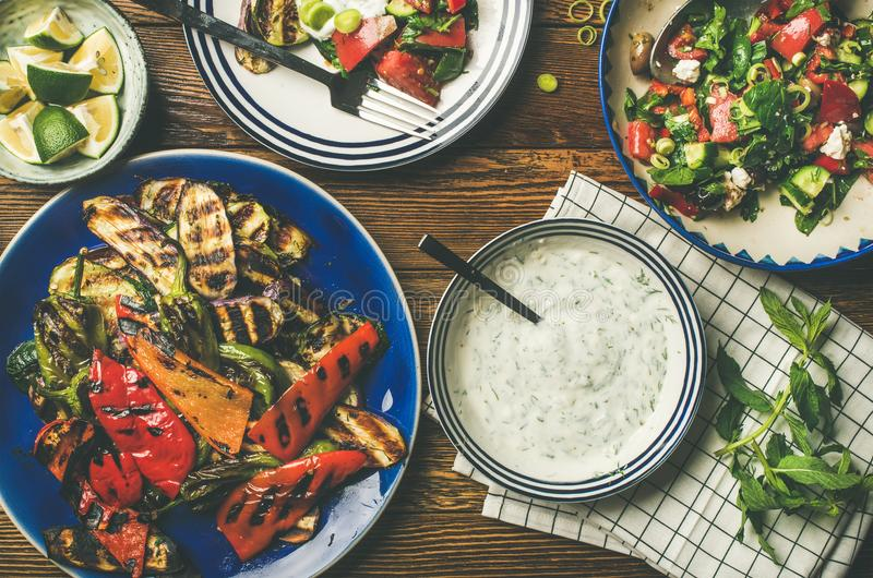 Flat-lay of vegan dinner table setting with healthy appetizers stock photos