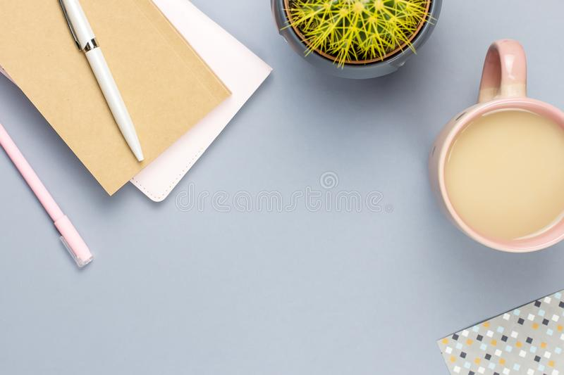 Flat lay home office desk. Female workspace with note book, eyeglasses, tea mug, diary, plant. Copy space royalty free stock photos