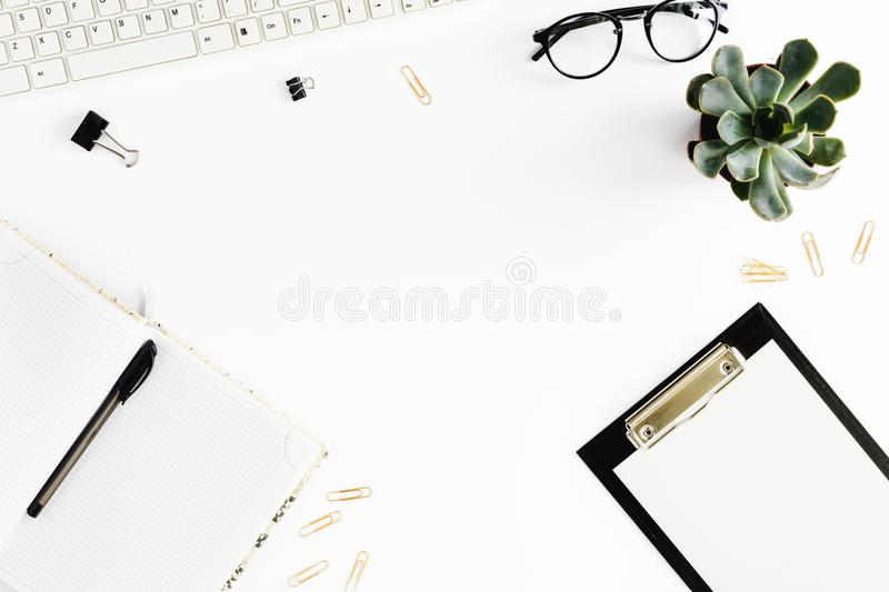 home office desk. Women workspace clipboard, notebook, keyboard, glasses royalty free stock image