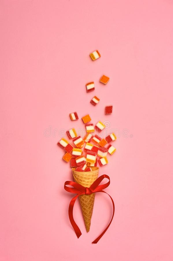 Flat lay : Ice cream cone with colorful party streamers on yellow background with copy space stock photography