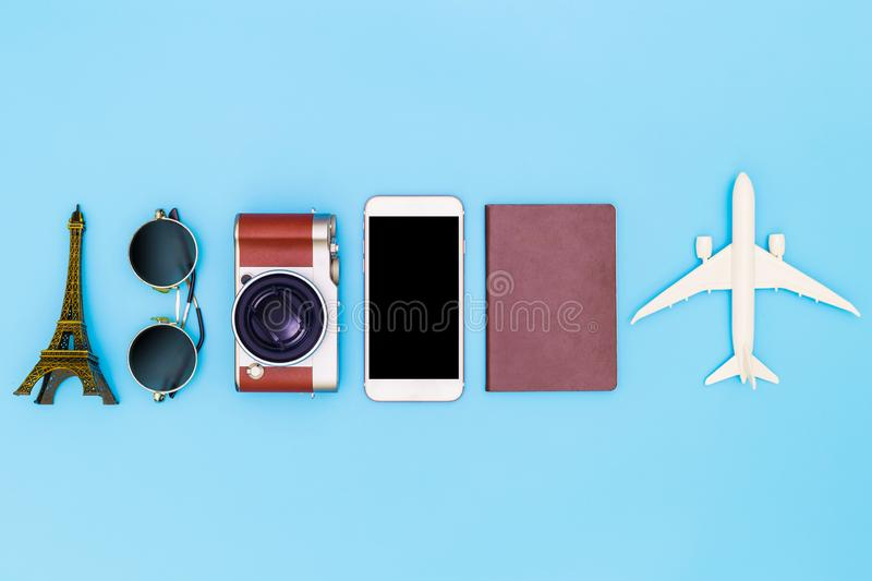 Flat lay image of accessory clothing to plan travel in holiday on blue background, Travel concept, Overhead view of Traveler`s royalty free stock photo