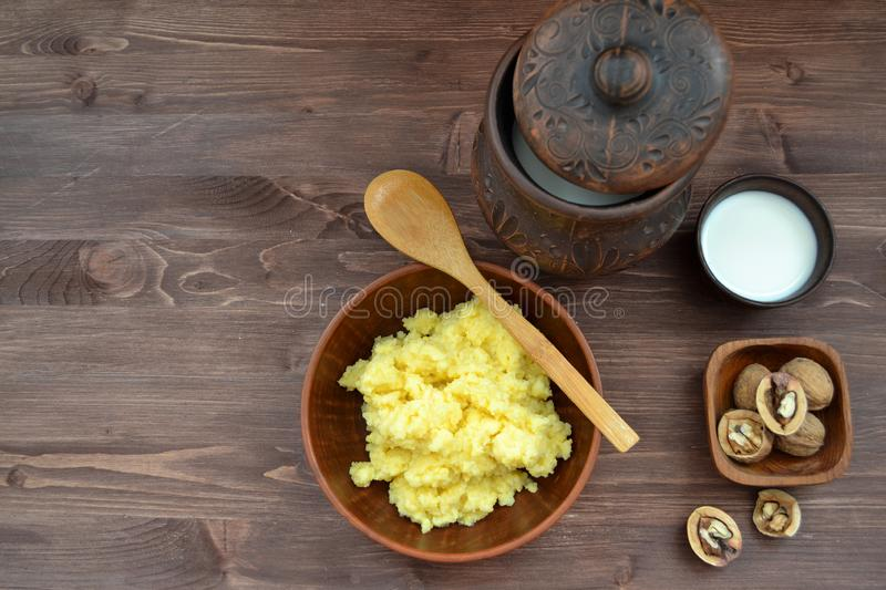 Flat lay image : healthy breakfast. Russian traditional cuisine with millet and maize porridge, walnuts and  milk royalty free stock photos