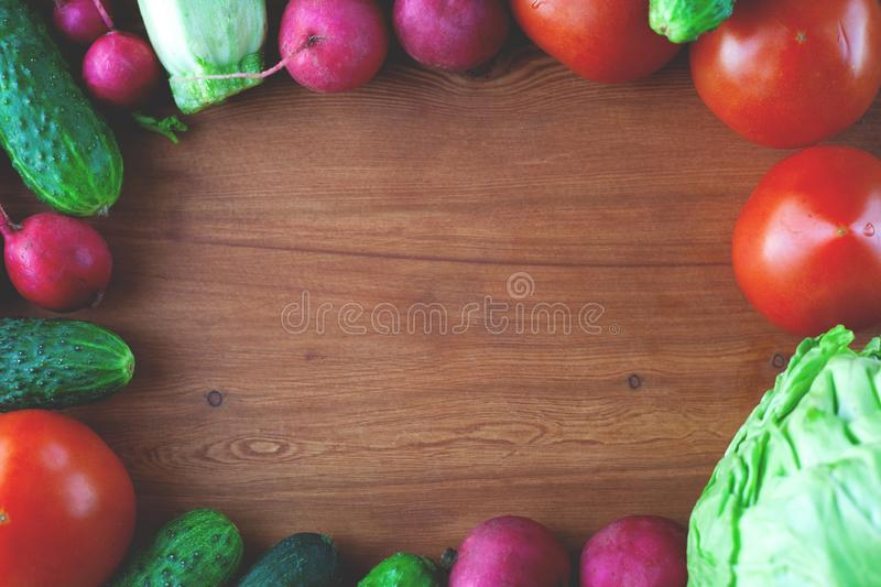 Flat lay lifestyle  fresh vegetable frame on wooden background  top view stock image