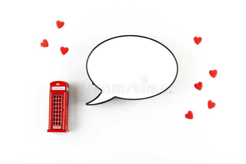 Flat lay with London phonebooth and light box in form of speech bubble with copy space for text stock photography