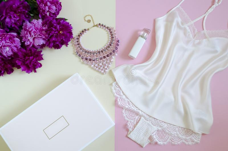 Flat lay, magazines, social networks. top view of feminine white lace. beauty concept. women`s fashion accessories,silk,  perfume stock photography