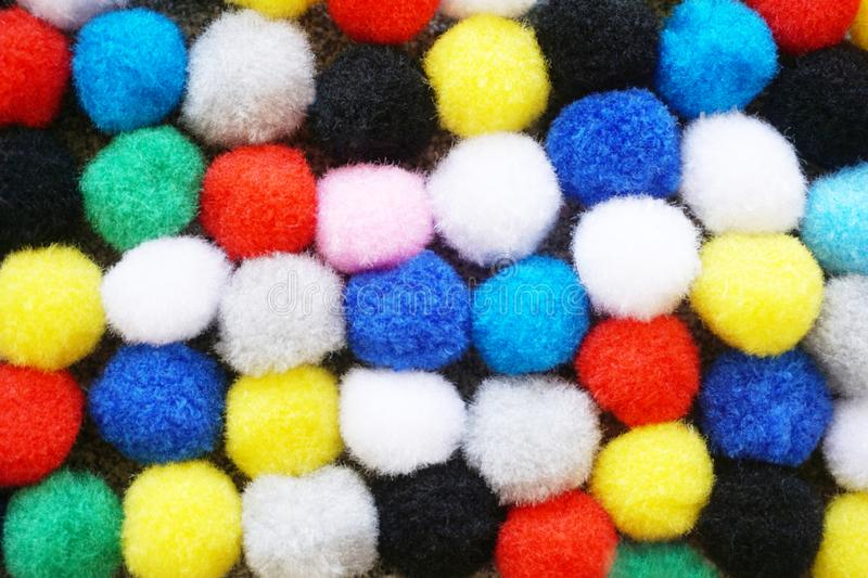 Flat lay colorful fluffy pom poms background royalty free stock images