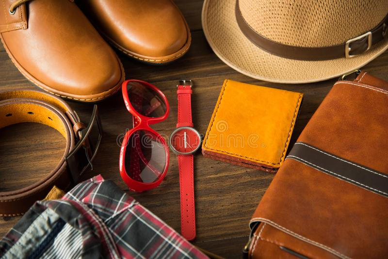 Flat lay of men casual fashion on wooden floor royalty free stock photo