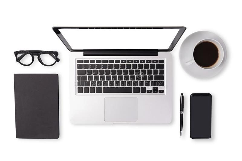Flat lay of men device accessories in black tone color on office desk table such as notebook laptop computer , cup of coffee. Glasses , pen , mobile smart royalty free stock images
