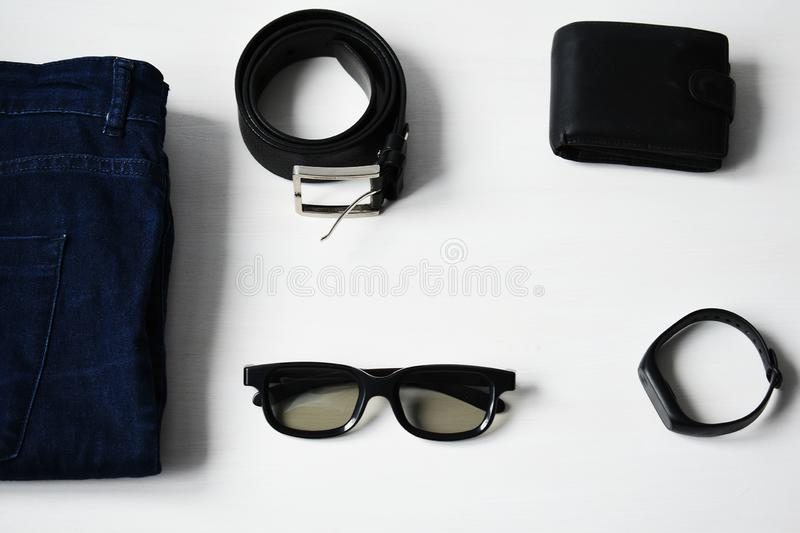 Flat lay, Men`s fashion casual outfits and accessories with space on white wooden background. Men`s fashion casual outfits and accessories with space on white stock images