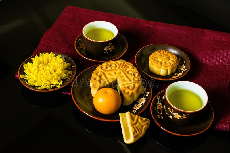 Flat lay modern stylised mid autumn festival food on black background. Flat lay modern stylised mid autumn festival food on black background royalty free stock images