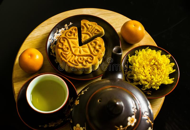 Flat lay modern stylised mid autumn festival food on black background. Flat lay modern stylised mid autumn festival food on black background stock images